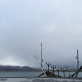 Sun Voyager is a sculpture by Jón Gunnar Árnason, in front of low lying grey clouds