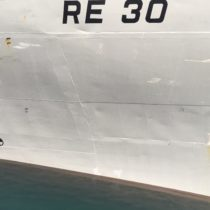 "Hull of an Iceland Navy ship with a tiny ""Atomic"" symbol."