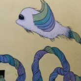 Mural at the side of a house, some birdlike creature with a long winded colourful tail