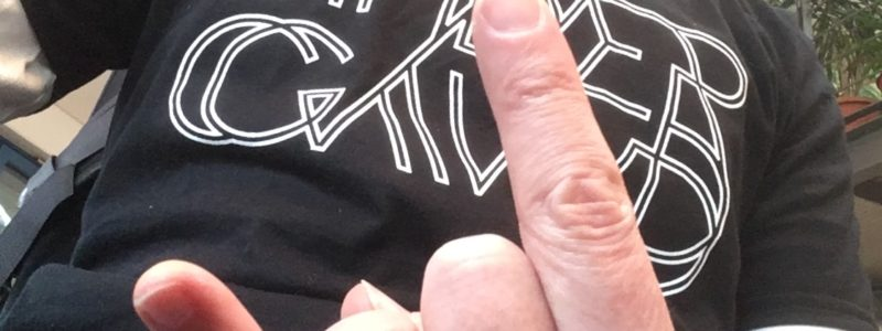 """Hand showing the """"rock"""" two finger salute in front of the chest , wearing the Spidergawd logo T-Shirt"""