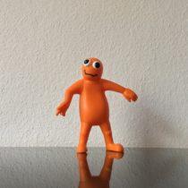 Orange rubber figure, ca 15cm, front