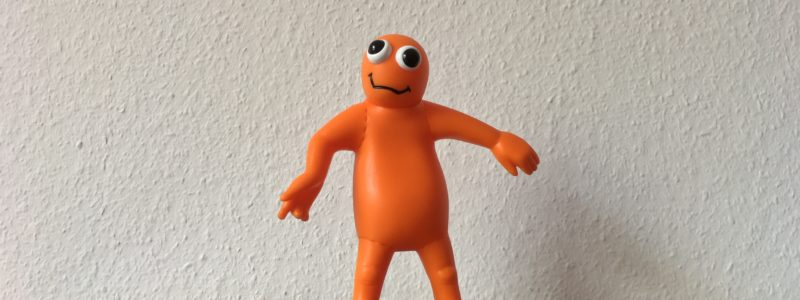 Orange rubber figure, ca 15cm, front